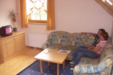 Wohnzimmer Ferienwohnung Löwenzahn