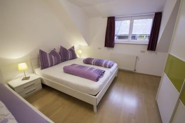 Schlafzimmer mit 3 Betten Ferienwohnung Erholung pur