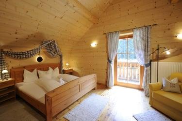 Schlafzimmer Kärntner Ferien- Holzhaus