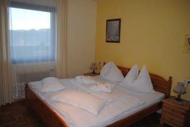 Sonnenblumenwohnung Bett