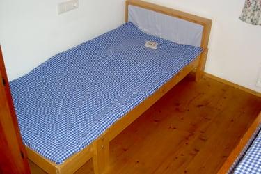 Ferienwohnung MARGERITE - Kinderbett