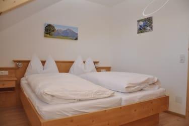 Schlafzimmer - Ferienwohnung Pyhrgas