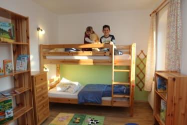 Ferienwohnung Kachelofen - Kinderzimmer
