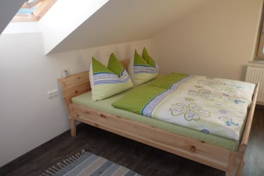 Ferienwohnung Kaminfeuer - Schlafzimmer