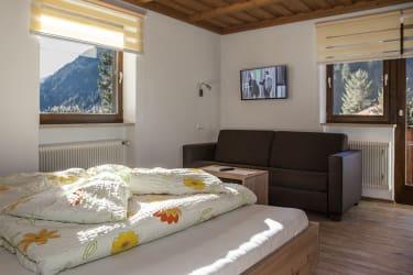 Wohnung Parseier - Doppelbettzimmer mit ausziehbarer Couch