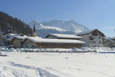Rosenhof (farm and house) in the Winter. The skiing area Bergkastel in the background.