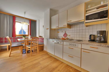Kitchen with eating place of apartment