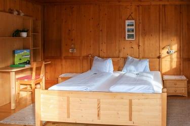 chambre du logement de vacances Almblick