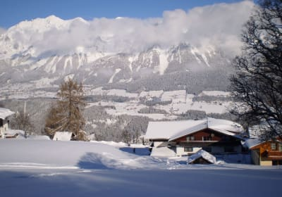 House in winter with mountain view