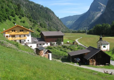 View from the south (an overall view of the farm): Smoke house, heated garage, private chapel, farm buildings, overlooking the valley and meadows in Umhausen and behind the ski and hiking area of Hochötz.