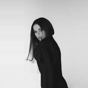 Vampire with black hair in black dress