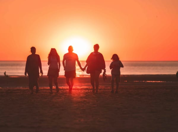 Familly on the beach with sunset