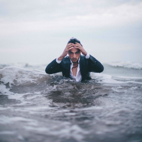 Stressed man in water