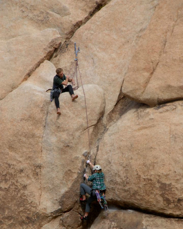 Two people doing rock climbing