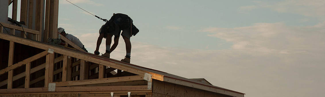 construction worker working on a building roof