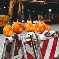 Street construction site with safety signs