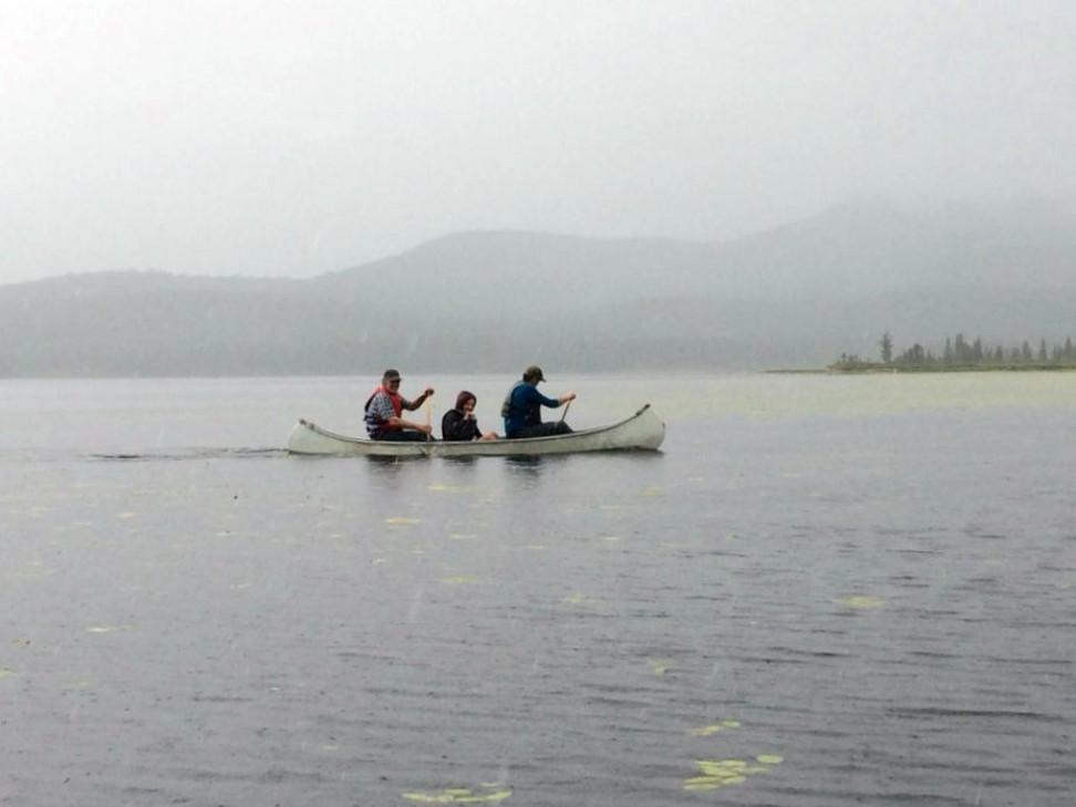 Canoe in the rain