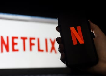 (FILES) In this file photo taken on March 31, 2020 In this photo illustration a computer and a mobile phone screen display the Netflix logo on March 31, 2020 in Arlington, Virginia. - US streaming giant Netflix announced on November 25, 2020 that it has doubled its investments in the UK to $1 billion by 2020, despite the disruption caused by the pandemic. (Photo by Olivier DOULIERY / AFP)