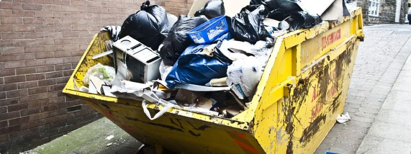 Overfilled dumpster before junk removal