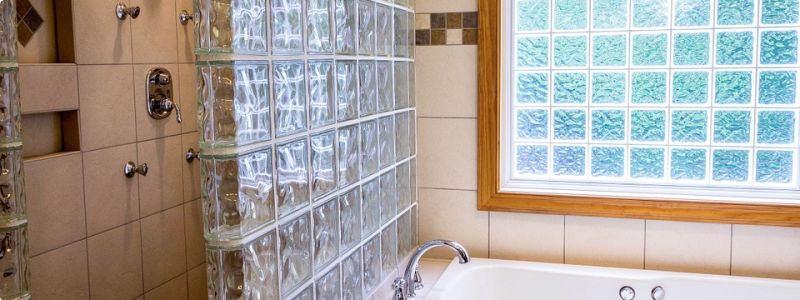 Bathroom with glass block window and glass block window wallafter replacement