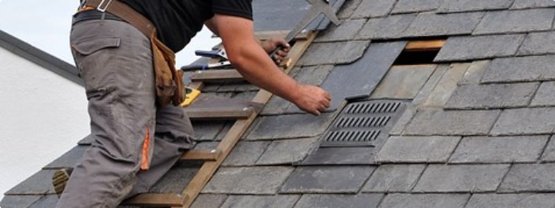 Small roofing repair by a roofer