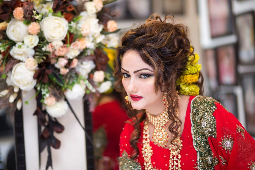 Evolver Media, India. woman-in-red-embroidered-top-1385478-scaled_vkgvcd evolver-media-wedding-cinematography-red-camera