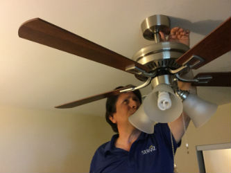 Putting the final touches on a Hampton Bay ceiling fan.