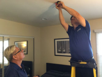Electrician Robert C. preps the ceiling for installation.