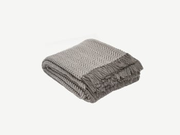 Taupe blanket with a white herringbone pattern.