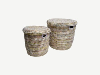 Woven baskets with natural straw base colour and subtle colorful weave in yellow, white and pink.