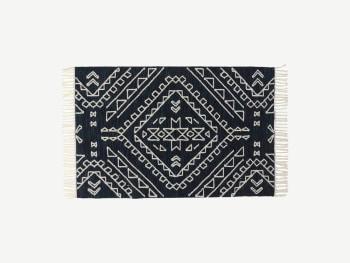 Blue and white kilim rug.