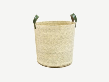 Woven basket with green handles.