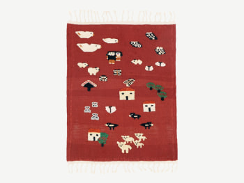 Red rug with playful subjects (animals, houses...9 added as a relief subject.