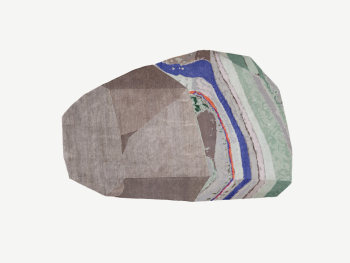 Rug whose shape resembles a rock.