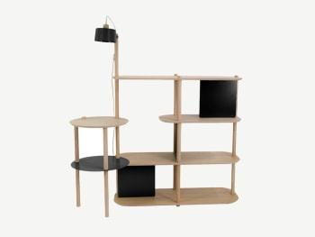 Light wood shelving unit with lamp and table modules attached.
