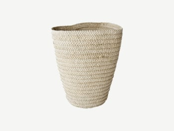 Small woven basket finished with white thread.
