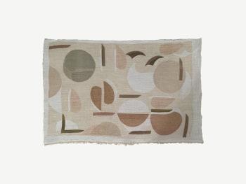 Textile cloth with geometric print.