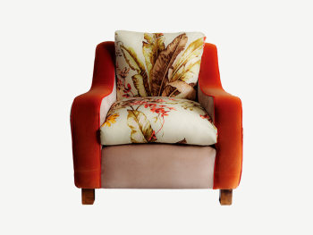 Vintage armchair reupholstered in floral fabric.
