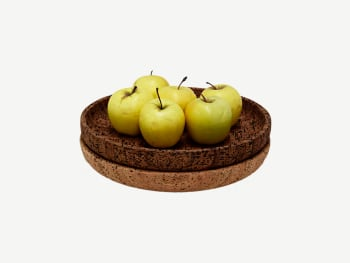 Cork bowls containing apples.