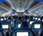7 Yoga Poses You Can Do on an Airplane