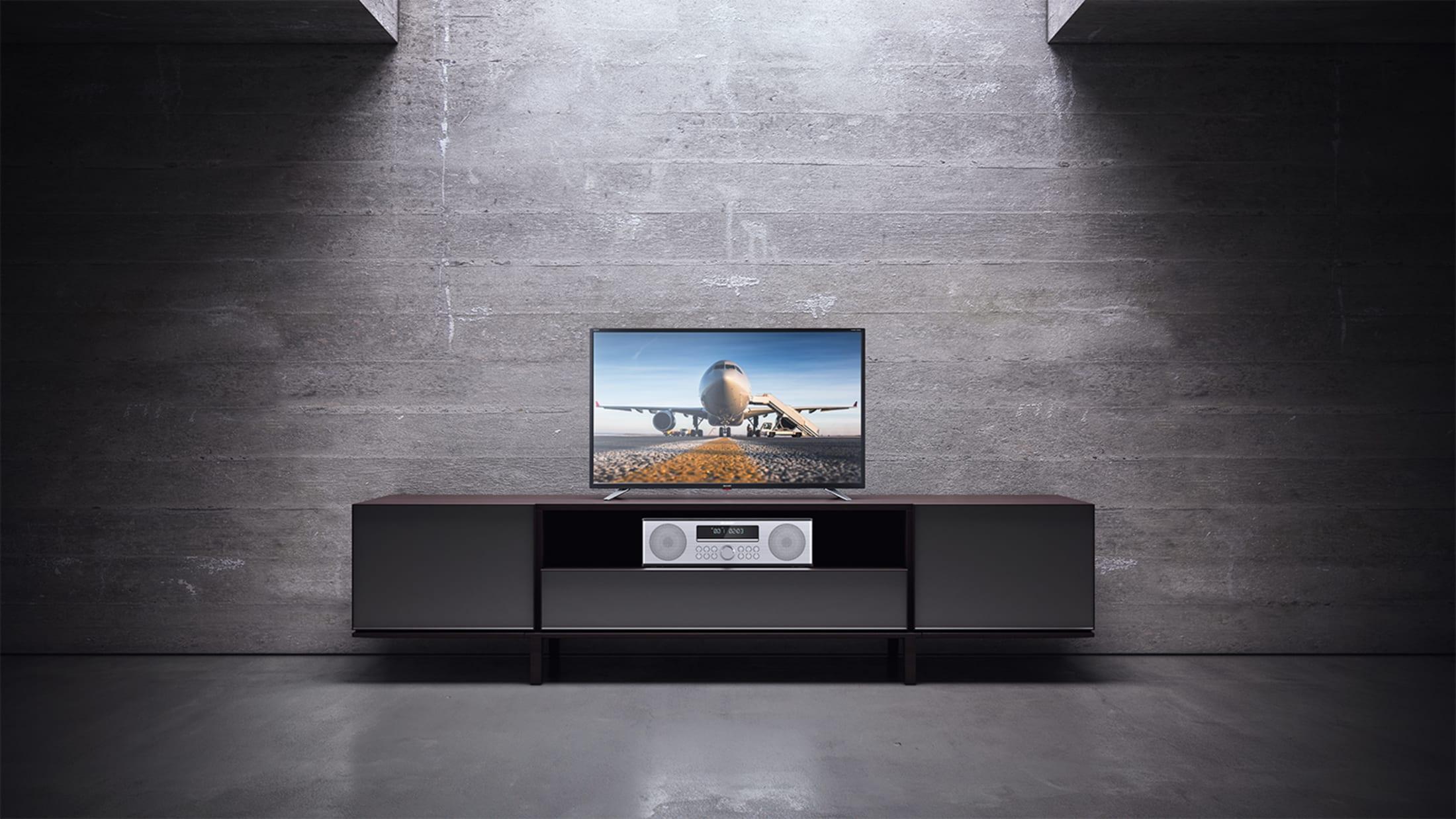 Stereofoniczny system nagłośnienia All-in-One, 90 W, zdobywca nagrody reddot design award 2018, z bezprzewodowym strumieniowaniem muzyki przez Bluetooth, Odtwarzacz CD, Tuner DAB/DAB+/FM i pilot.