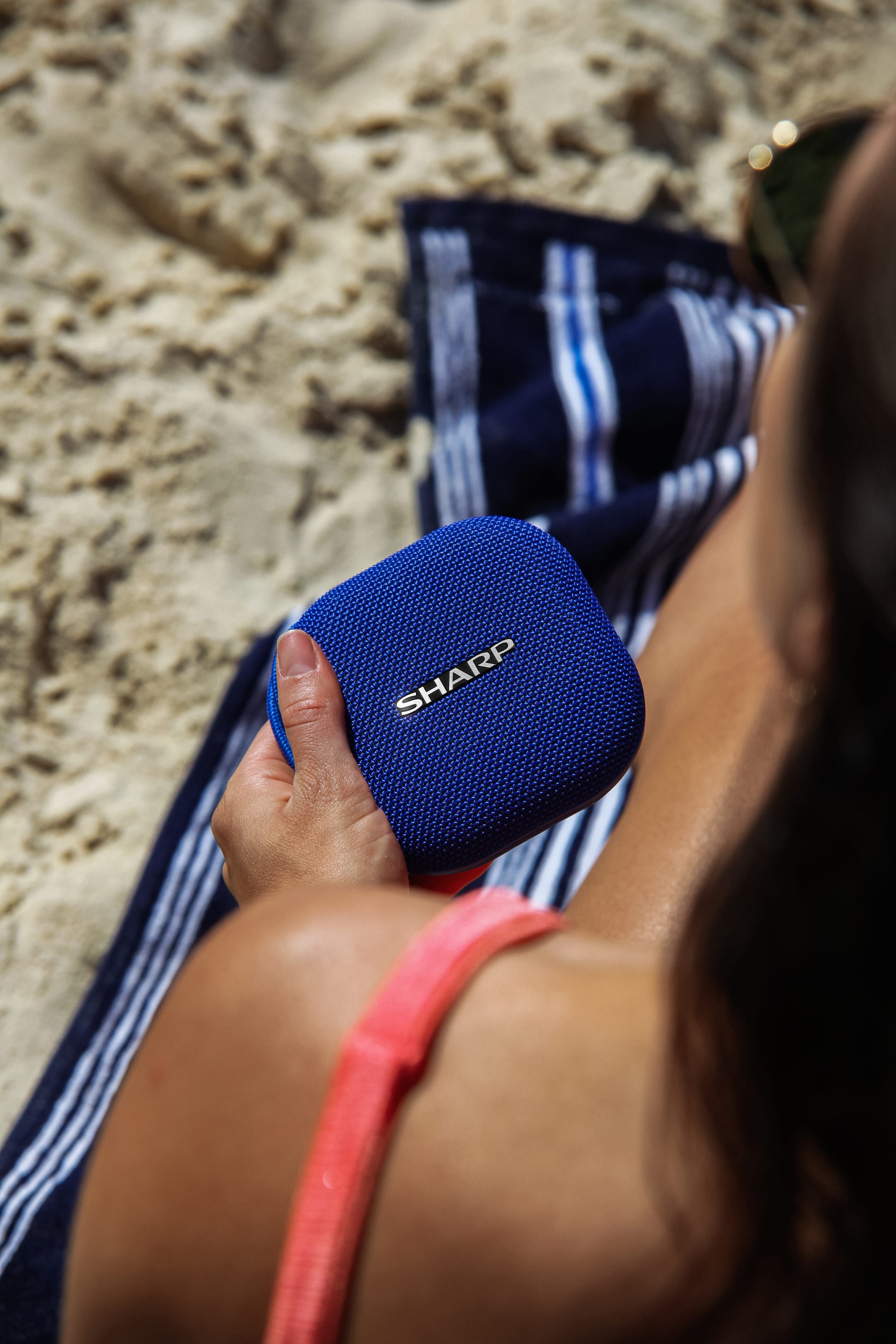 A waterproof, compact Bluetooth speaker with a big battery life