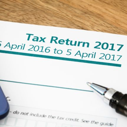 I've just come to the UK to live for the first time, should I be filing UK tax returns whilst I am here? - news article image