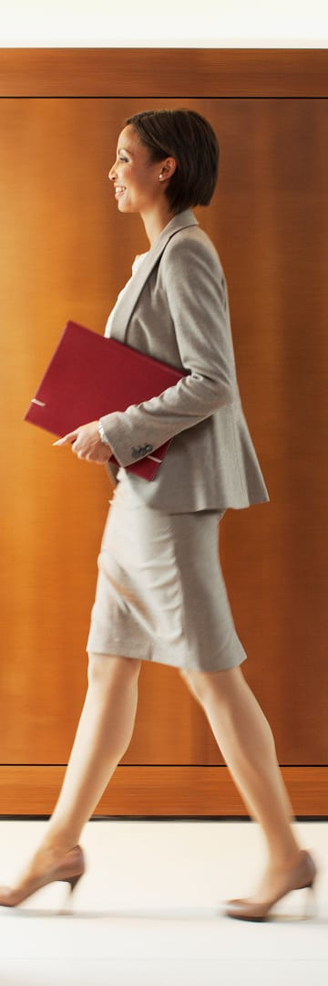 Businesswoman with red folder.