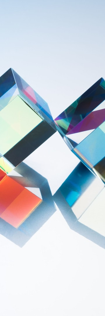 X-cube prism in a row on silver background, Shearman accolades