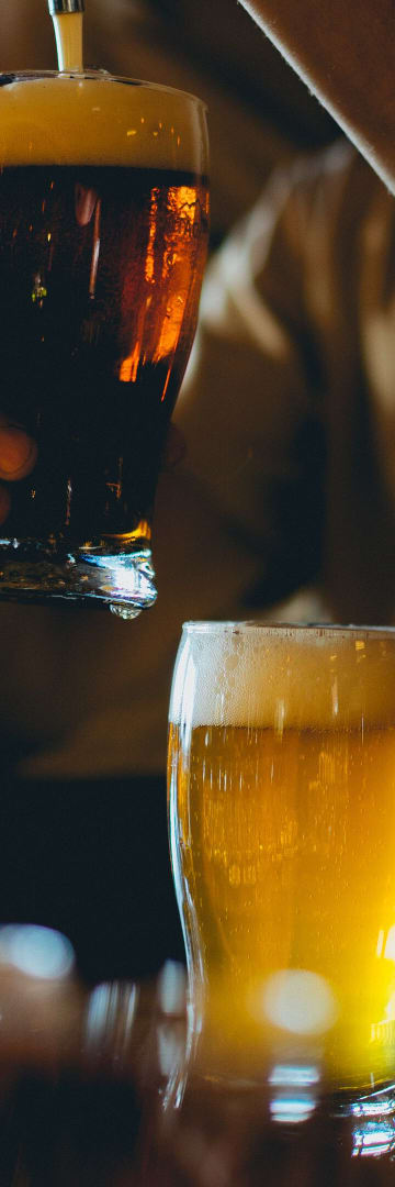 Hospitality - Filling Pint Glasses in a Pub