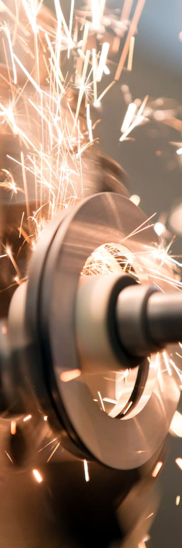 Industrial machines in motion with sparks flying out