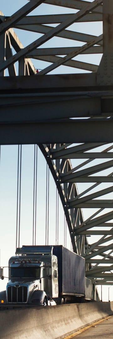 Semi-truck crossing George Desmond Bridge