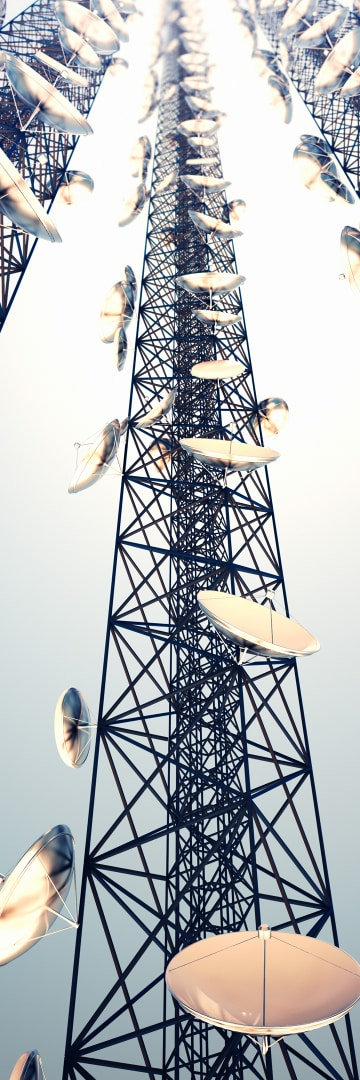Telecommunications tower with satellite dishes