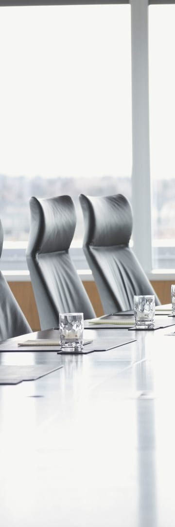 Boardroom table and chairs -- Shareholder Activism Trends in 2019
